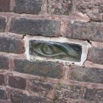 Glass eye built into wall